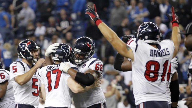 Houston Texans kicker Shayne Graham (17) is congratulated by Donnie Jones (5) and Ryan Harris (68) after kicking the game-winning field goal in overtime of an NFL football game against the Detroit Lions at Ford Field in Detroit, Thursday, Nov. 22, 2012. The Texans won 34-31. At right celebrating is Texans' Owen Daniels. (AP Photo/Rick Osentoski)