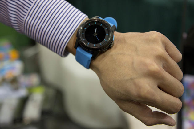 The Cookoo watch is modeled at the Consumer Electronics Show, Wednesday, Jan. 9, 2013, in Las Vegas. The watch allows users to stay connected with their mobile devices alerting them of incoming calls,