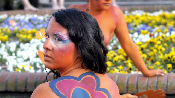 """A pro abortion activist, with her body painted, demonstrates in front of the Uruguayan congress in Montevideo, Uruguay, Tuesday, Sept. 25, 2012. Uruguay's congress appeared ready on Tuesday to legalize abortion, a groundbreaking move in Latin America, where no country save Cuba has made abortions accessible to all women during the first trimester of pregnancy. The sign reads in Spanish """"legal abortion.""""  (AP Photo/Matilde Campodonico)"""