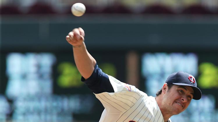 Minnesota Twins pitcher Anthony Swarzak throws against the Cleveland Indians in the first inning of a baseball game, Wednesday, July 23, 2014, in Minneapolis. Swarzak picked up the win in the Twins 3-1 victory. (AP Photo/Jim Mone)