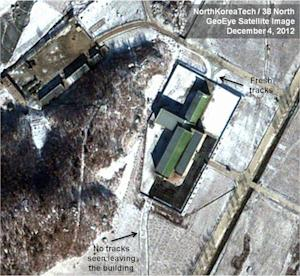 FILE - This Dec. 4, 2012 file satellite image taken by GeoEye  and annotated and distributed by North Korea Tech and 38 North shows snow covering the Sohae launching station in Tongchang-ri, North Korea, including the path where trailers would be used to move the rocket stages from the assembly building to the launch pad in preparation for a Dec. 10-22 launch. North Korea may postpone the controversial launch of a long-range rocket that had been slated for liftoff as early as Monday, Dec. 10, 2012, North Korean state media said Sunday, Dec. 9, 2012.  (AP Photo/GeoEye via North Korea Tech and 38 North, File) MANDATORY CREDIT