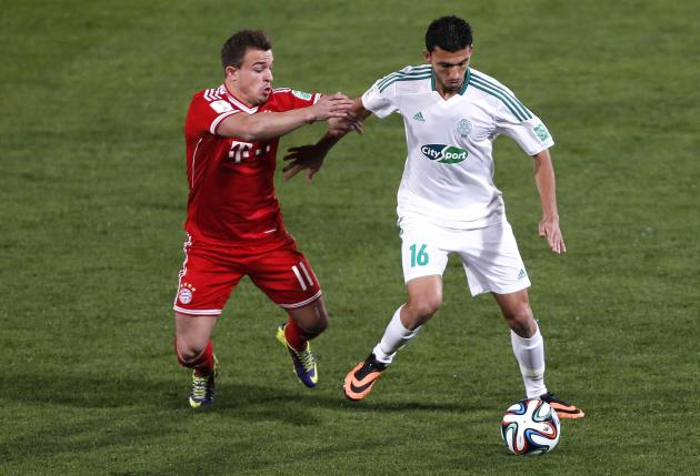 Mohamed Oulhaj of Morocco's Raja Casablanca fights for the ball with Xherdan Shaqiri of Germany's Bayern Munich during their 2013 FIFA Club World Cup final soccer match at Marrakech stadium