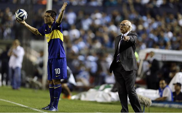 Boca Juniors' player Juan Roman Riquelme, left, and his coach Carlos Bianchi, right, react during an Argentine league soccer match against Racing Club in Buenos Aires, Argentina, Sunday, March 9,