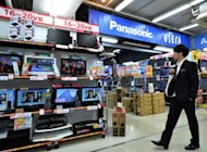 Panasonic television sets on display at a store in Tokyo. Standard & Poor&#39;s downgraded Panasonic&#39;s credit rating on Friday, the second time in a year, after the struggling Japanese electronics giant warned of a mammoth $9.6 bn annual loss