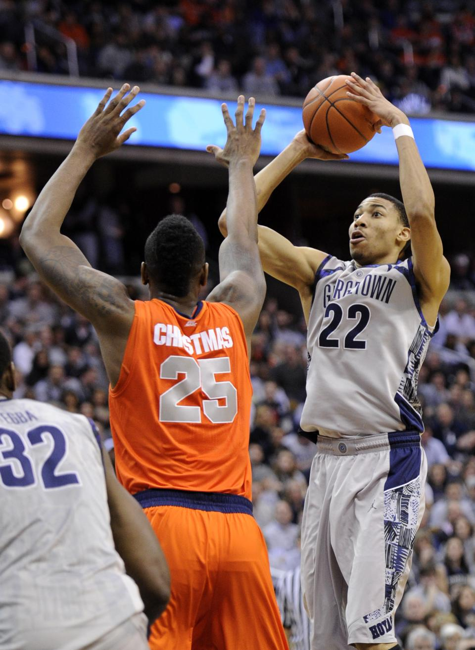 Georgetown forward Otto Porter Jr. (22) takes a shot against Syracuse forward Rakeem Christmas (25) during the second half of an NCAA college basketball game, Saturday, March 9, 2013, in Washington. Georgetown won 61-39. (AP Photo/Nick Wass)