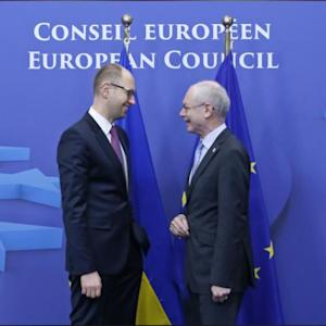EU Leaders To Slap Initial Sanctions On Russia