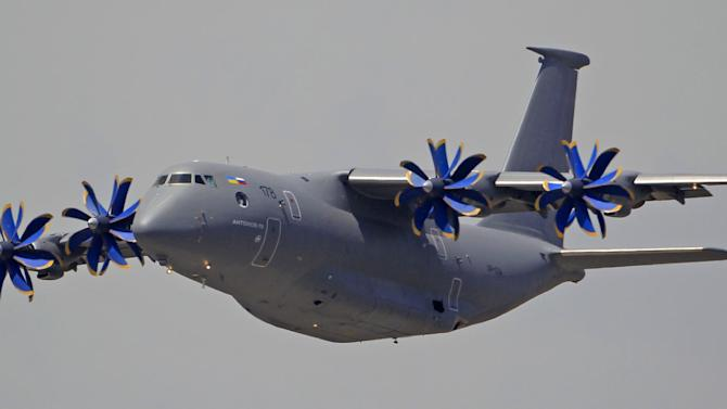 A Ukrainian made Antonov 70 performs its demonstration flight, on the first day of the Paris Air Show at Le Bourget airport, north of Paris, Monday June 17, 2013. (AP Photo/Remy de la Mauviniere)
