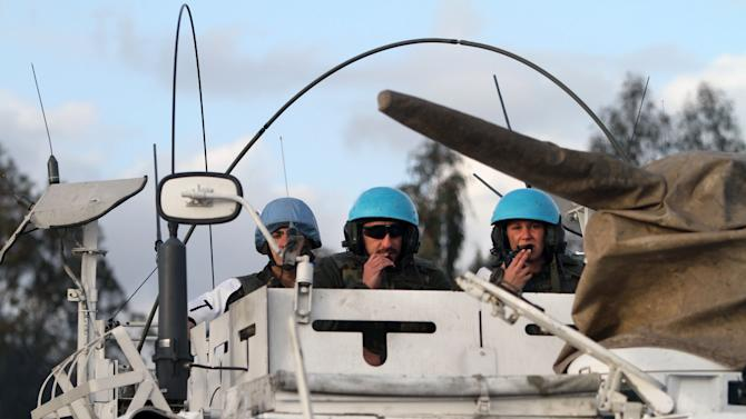 Spanish U.N. peacekeepers in an armored vehicle, patrol the Lebanese Israeli border, in the southern village of Abbasiyeh, Lebanon, Wednesday, Jan. 28, 2015. Missiles fired by the Lebanese Hezbollah group struck an Israeli military convoy on Wednesday, killing two soldiers in an apparent retaliation for a deadly airstrike attributed to Israel that killed many Hezbollah fighters in Syria earlier this month. A Spanish peacekeeper was killed in the border flare-up. He was identified by the Spanish Defense Ministry as Cpl. Francisco Javier Soria Toledo, 36. (AP Photo/Mohammed Zaatari)