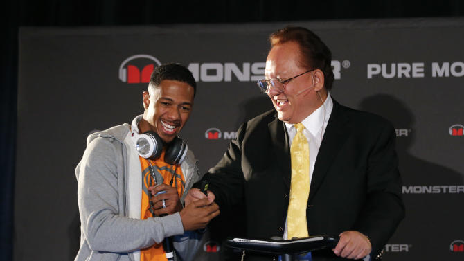 Recording artist Nick Cannon, left, shakes hands with Monster CEO Noel Lee during a new conference at the International Consumer Electronics Show in Las Vegas, Monday, Jan. 7, 2013. The 2013 International CES gadget show, the biggest trade show in the Americas, is taking place in Las Vegas this week. It's a place for technology companies to showcase the television sets, computers and other gadgets they plan. (AP Photo/Jae C. Hong)