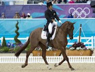 Japan's Yoshiaki Oiwa on Noonday de Conde competes in the dressage event of the equestrian eventing competition at the London 2012 Olympic Games in Greenwich Park, London. Japan's Yoshaki Oiwa outshone a posse of more established stars to take the lead in the individual Olympic Games eventing standings at the conclusion of a stormy dressage session on Sunday