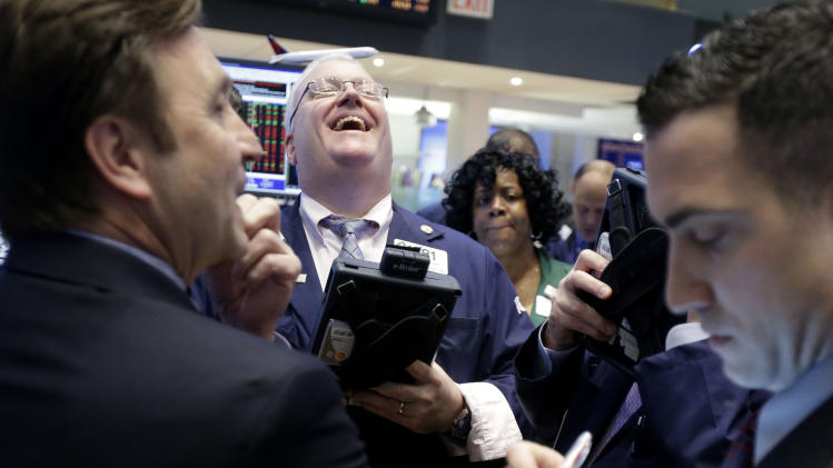 A trader laughs while working on the floor of the New York Stock Exchange in New York, Thursday, Jan. 31, 2013. The Dow edged higher Thursday, keeping the index on track for its best start to the year in more than two decades. (AP Photo/Seth Wenig)*