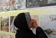 A Kurdish woman cries as she looks at pictures of victims of a 1988 gas attack by former Iraqi dictator Saddam Hussein, at the memorial site of the attack in the Kurdish town on Halabja