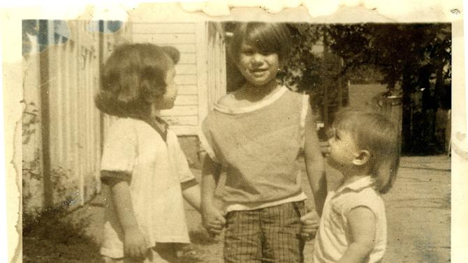 This 1967 photo provided by the family shows Donna Willing, center, with her sisters Barb and Virginia. Donna was raped and strangled in 1970. Police have identified Donna Willing's childhood neighbor as the alleged killer: 73-year-old Robert Hill. He's been in prison for other sexual assaults of children. The biological evidence in Donna Willing's case was lost or destroyed, and prosecutors are using Wisconsin's sex offender law to possibly keep him in custody indefinitely. They hope to prove Hill is a sexually violent person during a Monday, Nov. 19, 2012 hearing. (AP Photo/Family Photo via Milwaukee Journal-Sentinel)