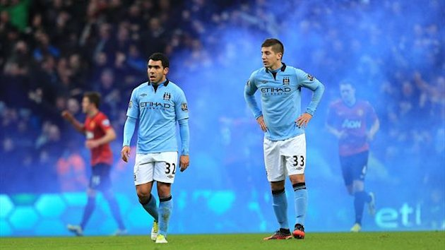 A flare set off by City fans during the Manchester derby (PA)
