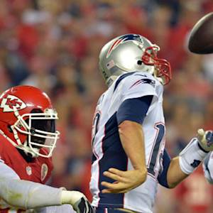 Kansas City Chiefs linebacker Tamba Hali forces and recovers fumble