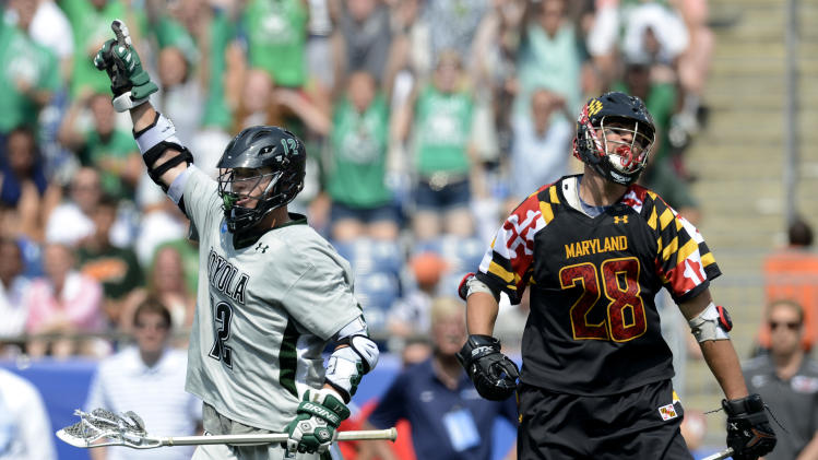 Loyola's Eric Lusby, left, celebrates a fourth quarter goal as Maryland's Michael Ehrhardt reacts, right, during their Division I NCAA men's lacrosse championship game at Gillette Stadium in Foxborough, Mass., Monday, May 28, 2012.  Loyola won 9-3. (AP Photo/Gretchen Ertl)