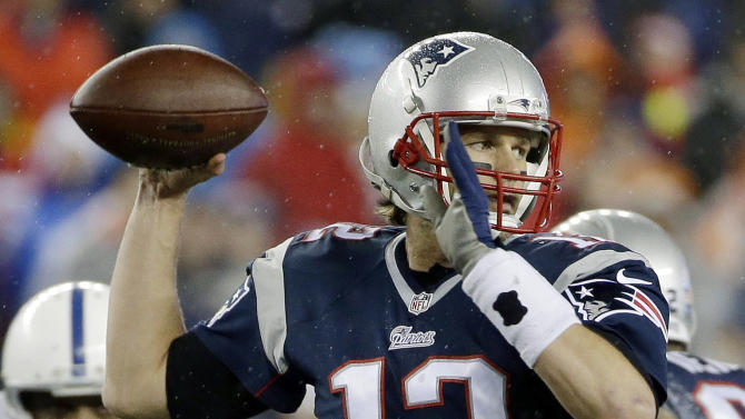 "FILE - In this Jan. 18, 2015, file photo, New England Patriots quarterback Tom Brady looks to pass during the first half of the NFL football AFC Championship game against the Indianapolis Colts  in Foxborough, Mass. An NFL investigation has found that New England Patriots employees likely deflated footballs and that quarterback Tom Brady was ""at least generally aware"" of the rules violations. The 243-page report released Wednesday, May 6, 2015, said league investigators found no evidence that coach Bill Belichick and team management knew of the practice. (AP Photo/Matt Slocum, File)"