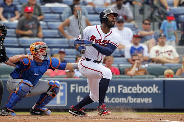 Atlanta Braves  Jason Heyward follows through on his single in the seventh inning of the first game of a baseball doubleheader  against the New York Mets Tuesday, June 18, 2013, in Atlanta
