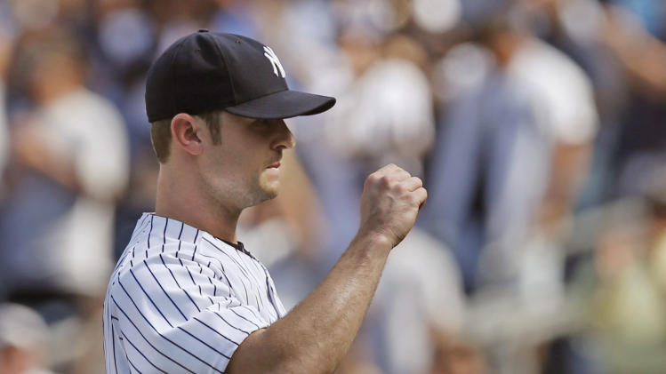 New York Yankees relief pitcher David Robertson (30) reacts after striking out the final batter in the Yankees 4-2 victory over the Texas Rangers in a baseball game at Yankee Stadium in New York, Thursday, July 24, 2014. (AP Photo)