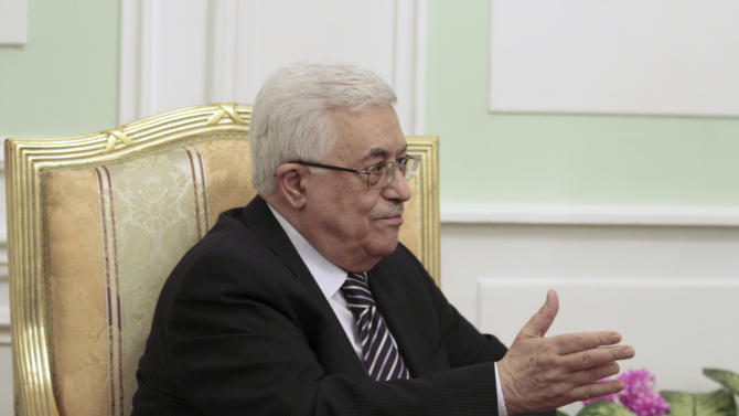 Palestinian President Mahmoud Abbas gestures during his meeting with Field Marshal Mohamed Hussein Tantawi, the head of Egypt's ruling Supreme Council of the Armed Forces (SCAF), in Cairo, Egypt, Thursday, Dec. 22, 2011. The Hamas militant group has agreed to join the Palestine Liberation Organization _ a key step toward unifying the long-divided Palestinian leadership. (AP Photo/Reuters, Mohamed Abd El-Ghany, Pool)
