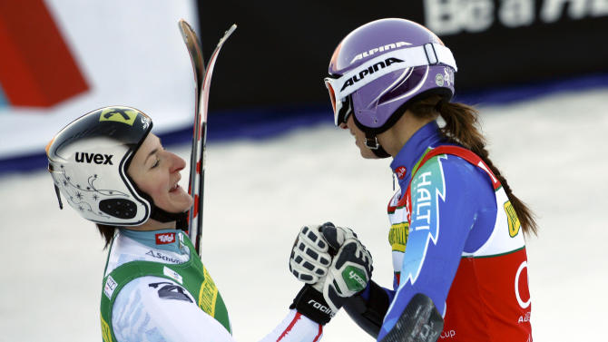 CORRCTS ZETTEL FINISHING SECOND , NOT THIRD - Kathrin Zettel, left, from Austria, congratulates Tina Maze from Slovenia in the finish area after Maze won the women's Nature Valley World Cup Giant Slalom ski race in Aspen, Colo., on Saturday, Nov. 24, 2012. Zettel finished second. (AP Photo/Alessandro Trovati)
