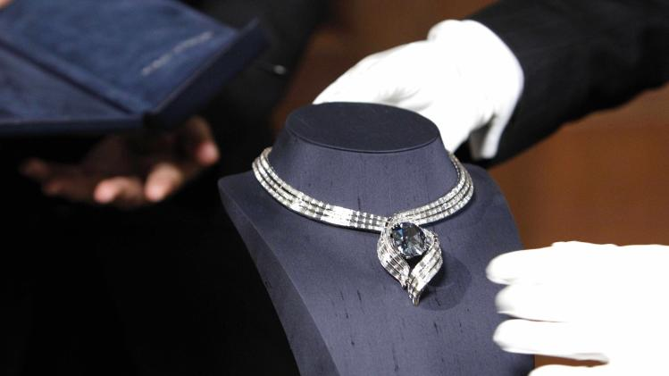 "The Hope Diamond is seen in its new temporary setting, ""Embracing Hope,"" Thursday, Nov. 18, 2010, at the Smithsonian National Museum of Natural History in Washington. The temporary setting is platinum with 340 baguette diamonds and took more than eight months to create. (AP Photo/Ann Heisenfelt)"