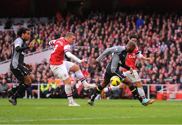 Lukas Podolski, left, gave Arsenal a first-half lead to set up a comfortable victory