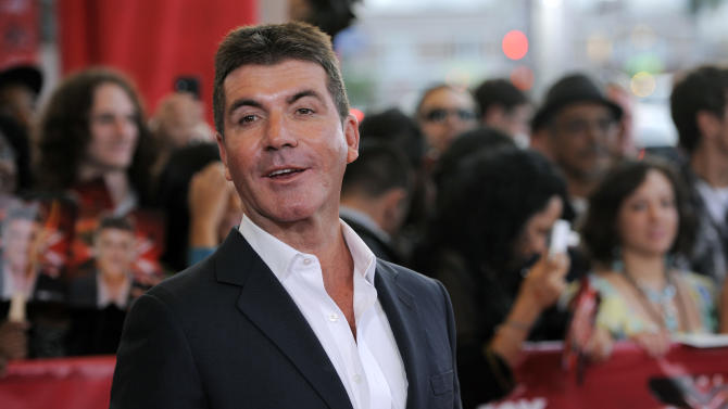 "Simon Cowell, executive producer and a judge on ""The X Factor,"" poses at a world premiere screening event for the new television series, Wednesday, Sept. 14, 2011, in Los Angeles. The competition series gives viewers the opportunity to choose the next breakout music star or group. (AP Photo/Chris Pizzello)"