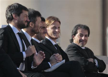 Members of Argentine soccer team San Lorenzo attend Pope Francis' Wednesday general audience in Saint Peter's square at the Vatican