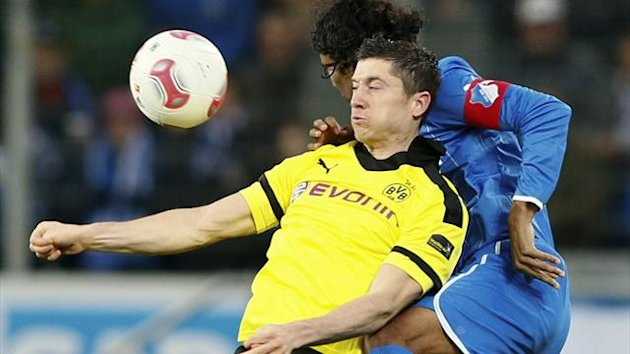 Hoffenheim's Compper challenges Borussia Dortmund's Lewandowski during their German first division Bundesliga match in Sinsheim