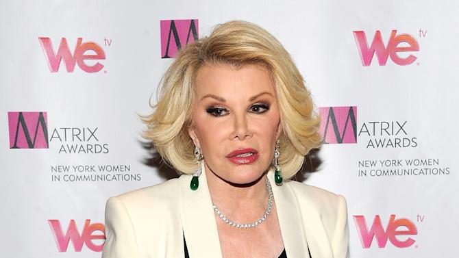 FILE - In this April 22, 2013 file photo, Television personality Joan Rivers attends the 2013 Matrix New York Women in Communications Awards at the Waldorf-Astoria Hotel, in New York. The comedian and condo board president Rivers is being sued for $15 million in a dispute involving a former downstairs neighbor in her luxury New York City building. The lawsuit was filed Wednesday, Oct. 9, 2013, in state Supreme Court in Manhattan. (Photo by Evan Agostini/Invision/AP, File)
