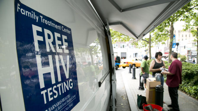"""Free HIV tests are offered as part of the Condom Nation tour on Friday, June 1, 2012 in Jersey City, NJ. The AIDS Healthcare Foundation launched a """"Condom Nation"""" tour to help promote condom use in an effort to reduce the HIV/AIDS infection rate. The initiative, which also involves free screenings and education sessions, spans 20 states during a six-month nationwide tour. (Charles Sykes /AP Images for AIDS Healthcare Foundation)"""