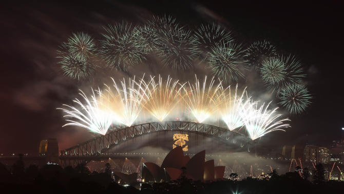 Fireworks explode in the sky above Sydney Harbour during the New Years Eve celebrations in Sydney, Australia, Tuesday, Jan. 1, 2013.(AP Photo/Rob Griffith)