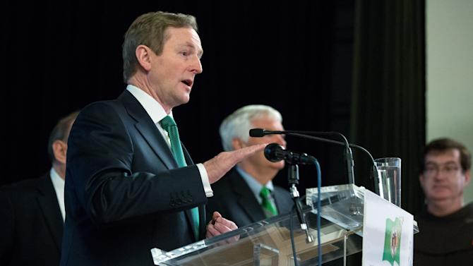 Irish Prime Minister Enda Kenny addresses the 17th annual St. Patrick's Day Breakfast of the Ireland Chamber of Commerce, in New York,  Saturday, March 16, 2013. he Irish, their descendants and the Irish for the day prepared to don green and pay tribute to Hibernian heritage as a weekend of St. Patrick's Day celebrations was set from New York's Fifth Avenue to the Louisiana bayou to Dublin's Parnell Square.   (AP Photo/Richard Drew)