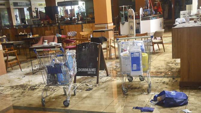 This photo taken Friday, Sept. 27, 2013 and made available Monday, Sept. 30, 2013, shows the scene at the Dormans coffee shop on the ground floor of the Westgate Mall in Nairobi, Kenya. The four-day siege, which included the collapse of part of the mall, left 67 people dead, according to officials. (AP Photo)