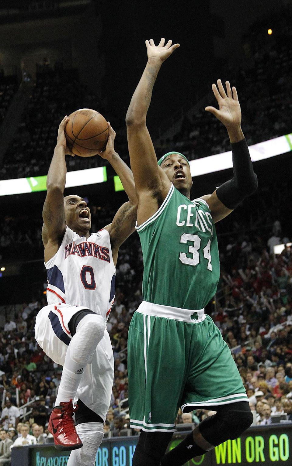 Atlanta Hawks guard Jeff Teague (0) drives to the basket as Boston Celtics forward Paul Pierce (34) defends during the first half of Game 5 of an NBA first-round playoff series basketball game Tuesday, May 8, 2012, in Atlanta. (AP Photo/John Bazemore)