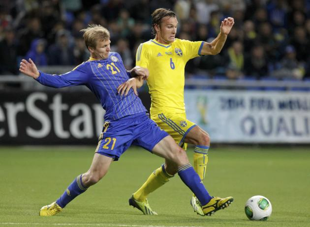 Kazakhstan's Valeri Korobkin fights for the ball with Sweden's Albin Ekdal during their 2014 World Cup qualifying soccer match at the Astana Arena stadium in Astana