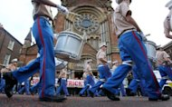 Orangemen march past St. Patrick's Catholic Church in north Belfast, Northern Ireland on September 29, 2012. Northern Irish police were on high alert as tens of thousands of Protestants marched through Belfast to mark 100 years since a landmark event in the history of Ireland's partition