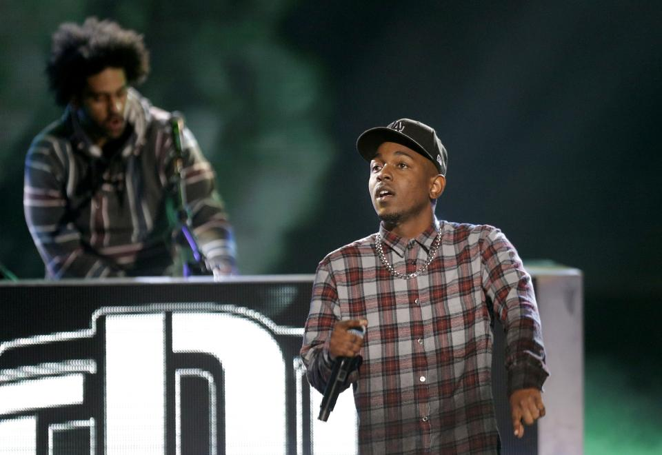 Rapper Kendrick Lamar, right, performs at the BET Hip Hop Awards, Saturday, Sept. 28, 2013, in Atlanta. (AP Photo/David Goldman)