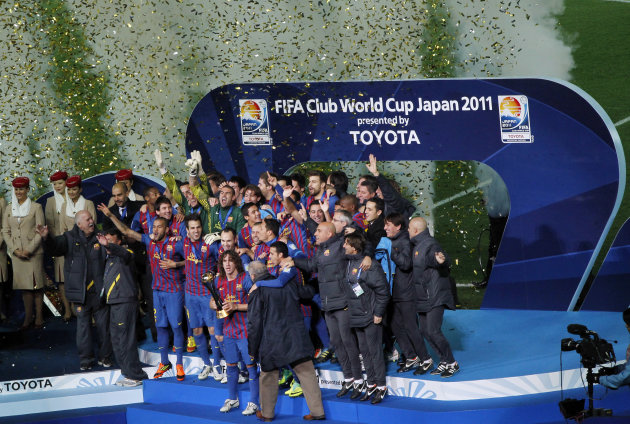 Spain's FC Barcelona's players celebrate for the team's victory over Brazil's Santon FC  at the final of the Club World Cup soccer tournament in Yokohama, near Tokyo, Sunday, Dec. 18, 2011. (AP Photo/