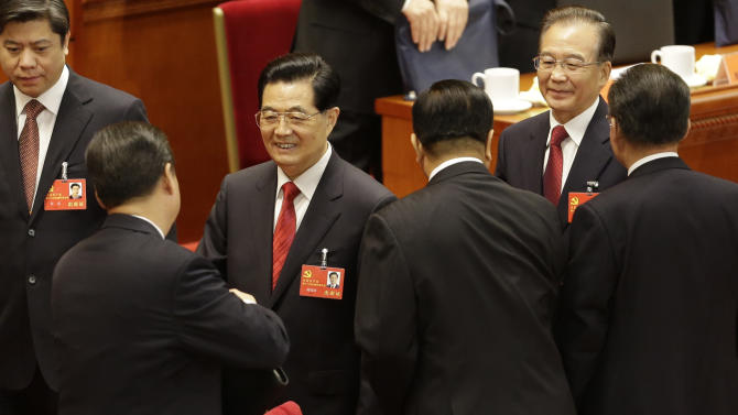 Chinese President Hu Jintao, third from left, shakes hands with Chinese Vice President Xi Jinping, front left, as Chinese Premier Wen Jiabao, right in the back, follows after the opening session of the 18th Communist Party Congress held at the Great Hall of the People in Beijing, China, Thursday, Nov. 8, 2012. Preparing to hand over power after a decade in office, China's President Hu called Thursday for sterner measures to combat official corruption that has stoked public anger while urging the Communist Party to maintain firm political control. (AP Photo/Lee Jin-man)