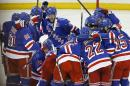The New York Rangers celebrate after beating the Pittsburgh Penguins 2-1 in overtime of Game 5 in the first round of the NHL hockey Stanley Cup playoffs, Friday, April 24, 2015, in New York. (AP Photo/Julie Jacobson)