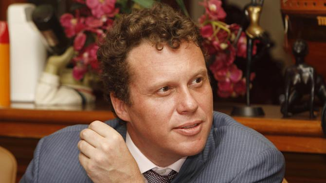 Russian businessman Sergei Polonsky, listens to a question during a press conference in Phnom Penh, Cambodia, Friday, April 25, 2014. Cambodia's highest court ruled Friday that a prominent Russian property developer wanted in his homeland for allegedly embezzling millions of dollars cannot be extradited. (AP Photo/Heng Sinith)