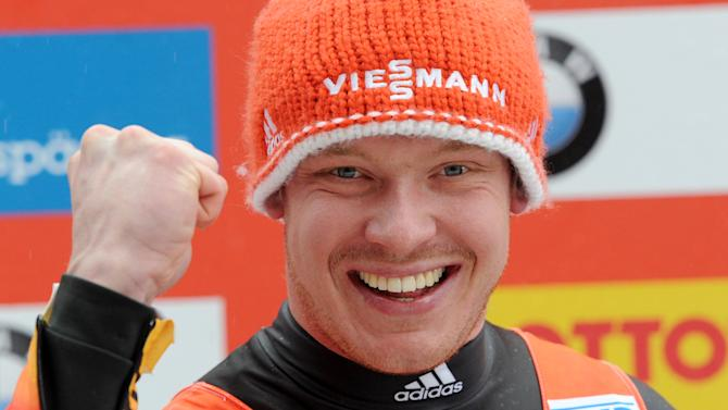 Felix Loch from Germany celebrates after he won the men's Luge World Cup in Koenigssee, Germany, Sunday, Jan. 5, 2014. (AP Photo/dpa,Tobias Hase)