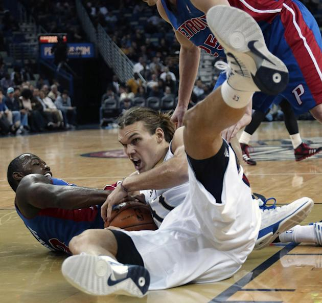 New Orleans Pelicans power forward Lou Amundson, right, battles for a loose ball with Detroit Pistons shooting guard Rodney Stuckey (3)  in the first half of an NBA basketball game in New Orleans, Wed