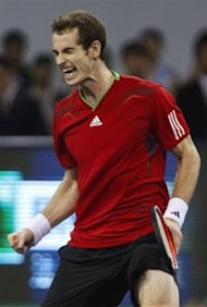 Andy Murray of Britain celebrates after defeating David Ferrer of Spain at their singles final match of the Shanghai Masters tennis tournament in Shan