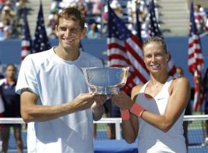 Hlavackova of the Czech Republic and Mirnyi of Belarus pose with their trophy after defeating Spears of the U.S. and Gonzalez of Mexico in the mixed doubles final at the U.S. Open tennis championships in New York