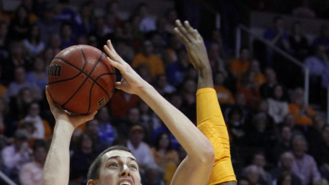 Kentucky forward Kyle Wiltjer (33) shoots over Tennessee guard Josh Richardson (1) in the first half of an NCAA college basketball game on Saturday, Feb. 16, 2013, in Knoxville, Tenn. (AP Photo/Wade Payne)