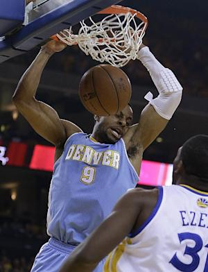 FILE - In this April 26, 2013, file photo, Denver Nuggets' Andre Iguodala (9) scores against Golden State Warriors' Festus Ezeli during the first half of Game 3 in a first-round NBA basketball playoff series in Oakland, Calif. The Golden State Warriors reached an agreement with Iguodala on a $48 million, four-year deal Friday, July 5, 2013, two people with knowledge of the situation said. The people spoke on condition of anonymity to The Associated Press because NBA rules prevent confirmation of moves until July 10. (AP Photo/Ben Margot, File)