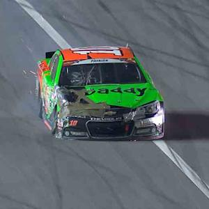 Danica cuts a tire and goes hard into the wall